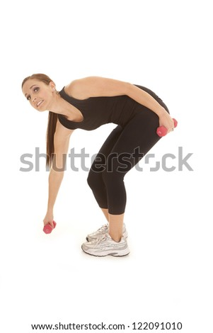 A woman having a hard time lifting up a little weight. - stock photo