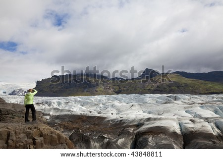 A woman hiker looking out on the Vatnajokull Glacier, Iceland