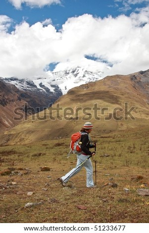 A woman hiking along the hills of Bhutan. - stock photo