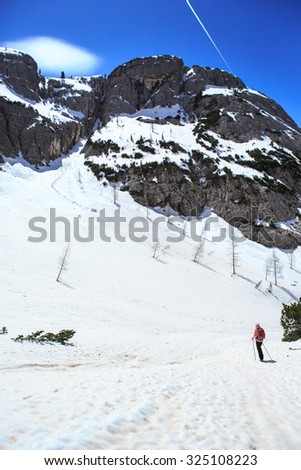A woman hiking in Drei Zinnen alias Tre Cime area in South Tirol, Italy