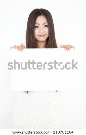 A Woman Hold A Message Board
