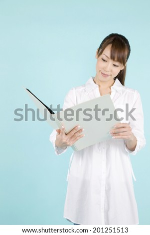 A woman holding a file