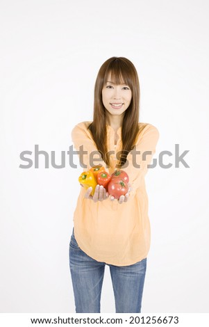 A woman holding a vegetable