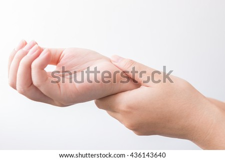 A woman holding her wrist, Office Syndrome - stock photo