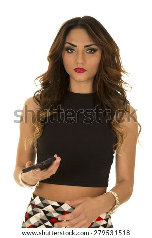 a woman holding on to her cell phone with a serious expression on her face. - stock photo