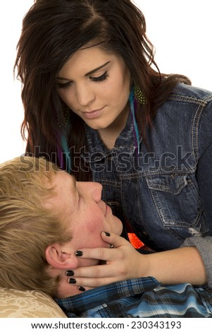 a woman holding on to her man's face looking deep into his eyes.