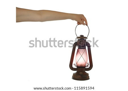 A woman holds up a sooty kerosene lantern. isolated on white - stock photo