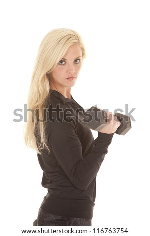 A woman in a black outfit is curling a weight. - stock photo