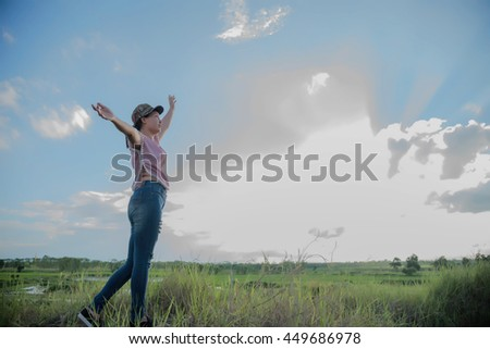 A woman in a field in the sky