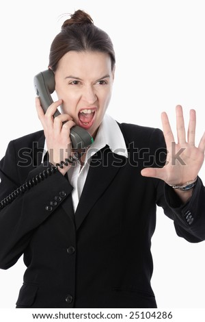 A woman in a financial trading role simulating selling activity. - stock photo