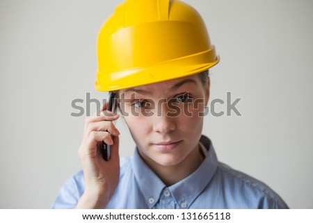 A woman in a helmet with a mobile phone