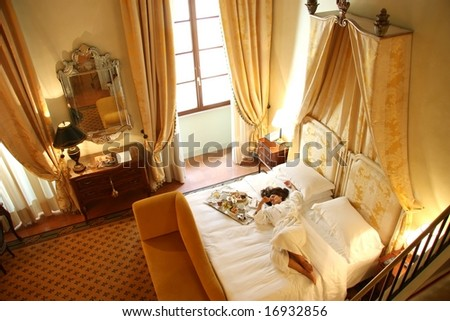 a woman in  a luxury hotel room