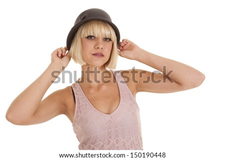 A woman in a purple dress and a black hat. - stock photo