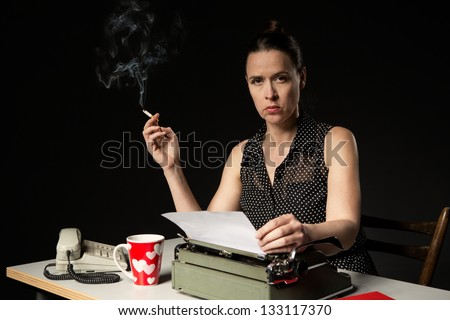 A woman in a simulated retro working scene - stock photo