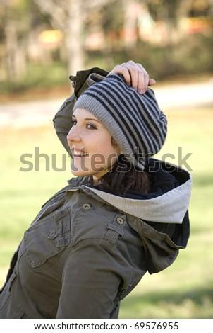 A woman in a striped beret - stock photo