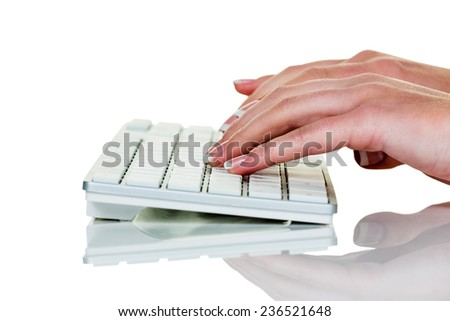a woman in an office working with a laptop computer - stock photo