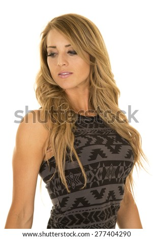 A woman in her black and grey designed dress looking over their shoulder. - stock photo