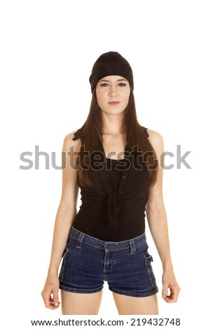 A woman in her black bandana and short shorts with a serious expression. - stock photo