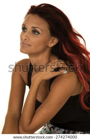 A woman in her business dress, looking to the side with red hair. - stock photo