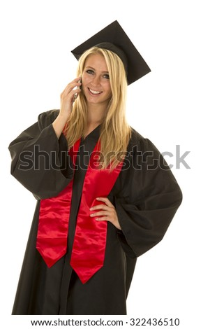 a woman in her cap and gown with a smile on her face. - stock photo
