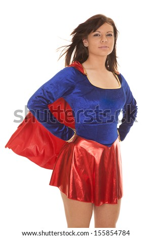 A woman in her costume with a cape and skirt. - stock photo