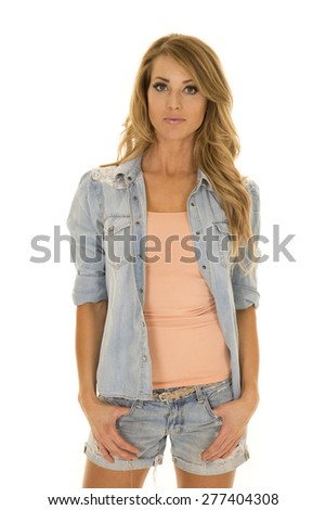 A woman in her denim shirt, with jean shorts.