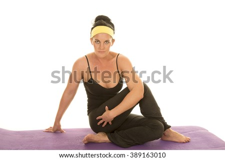 a woman in her fitness clothing stretching out her body. - stock photo