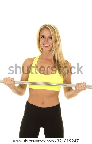 a woman in her fitness clothing using her bar.