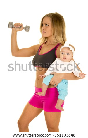 a woman in her fitness clothing working out with weights holding on to her little baby.