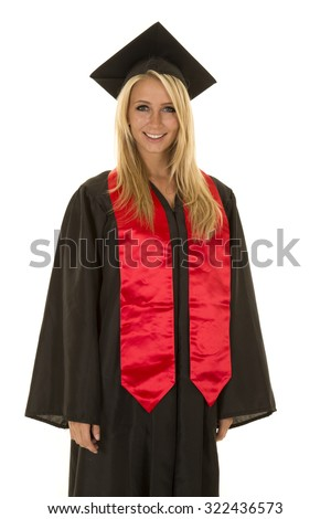 a woman in her graduation gown with a big smile on her face.