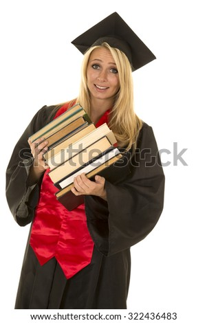 A woman in her graduation gown with a stack of books tipping over.