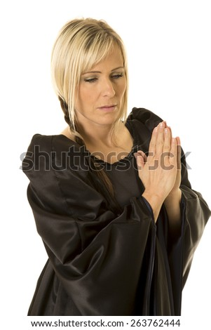 A woman in her medieval attire, praying. - stock photo