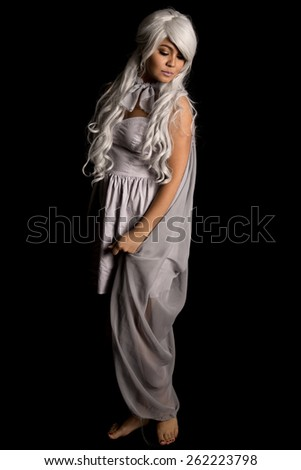 A woman in her mythical costume looking over her shoulder. - stock photo