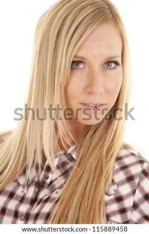 a woman in her plaid shirt with a small smile on her lips. - stock photo