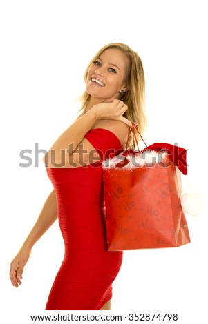A woman in her red Christmas dress shopping for the holiday.