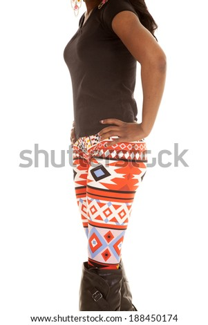 A woman in her red leggings with designs on them. - stock photo