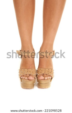 A woman in her shoes, with spikes on the toes. - stock photo
