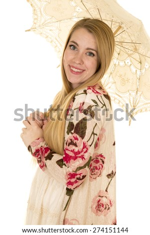 a woman in her sundress with her lace umbrella. - stock photo