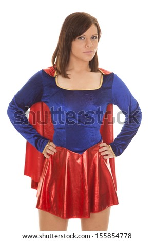 A woman in her super hero costume with her hands on her hips. - stock photo