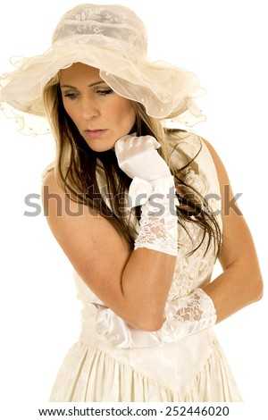A woman in her vintage dress, wearing her gloves and hat. - stock photo