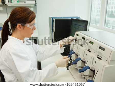 a woman in laboratory research. research in the research laboratory.