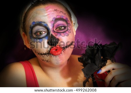 A woman in skull candy makeup for day of the dead celebrations.