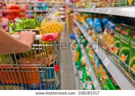 a woman in the purchase of food in a supermarket. everyday life of a housewife