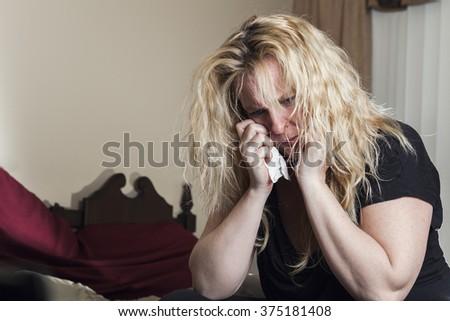 A woman inside is bedroom feel depress. - stock photo