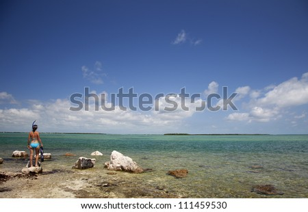 A woman is about to go snorkeling in the warm waters of the Florida Keys.