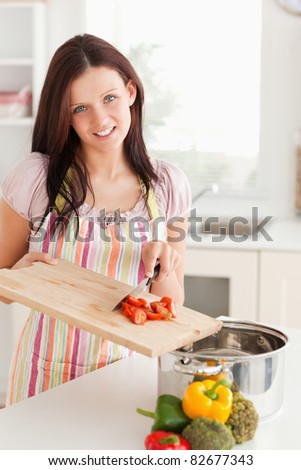A woman is cooking in the kitchen