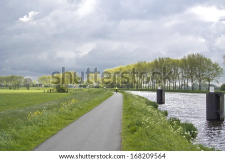a woman is cycling in the Netherlands