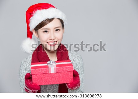 A woman is delivering Christmas gifts, asian - stock photo