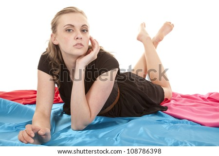 A woman is laying with her feet up behind her. - stock photo