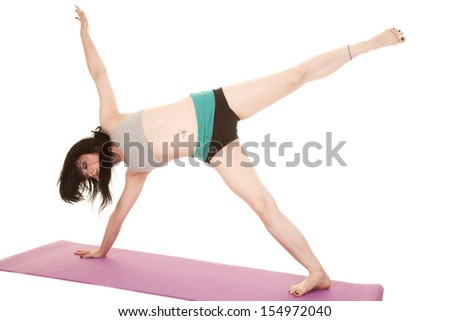 A woman is posing with one arm and one leg up. - stock photo